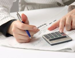 woman running budget calculations
